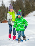 Happy kids playing winter Stock Photos