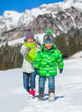 Happy kids playing winter Royalty Free Stock Photos