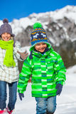 Happy kids playing winter Royalty Free Stock Images