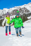 Happy kids playing winter Royalty Free Stock Image