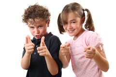 Happy kids pointing Stock Photo