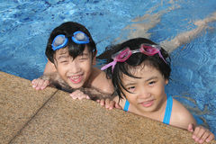 Happy kids in the pool Royalty Free Stock Photography