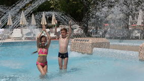 Happy kids in the pool stock footage
