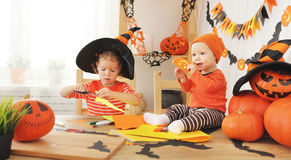 Happy kids preparing for Halloween decorated home bats handmade Royalty Free Stock Photos