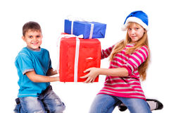 Happy kids with present boxes Royalty Free Stock Images