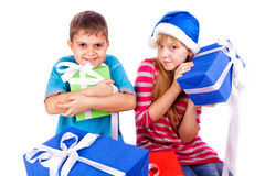 Happy kids with present boxes Stock Photography