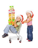 Happy kids with presents. Happy kids with christmas presents and a shopping cart - isolated Stock Images