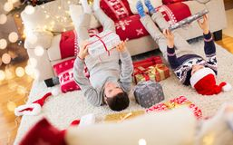 Happy kids with presents at Christmas time Royalty Free Stock Image