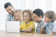 Happy kids programming on laptop royalty free stock photos