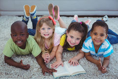 Happy kids reading a book together Royalty Free Stock Image