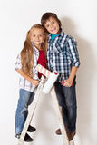 Happy kids ready to paint their room Stock Photos