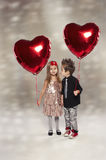 Happy kids with red heart balloon Royalty Free Stock Images