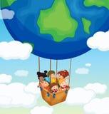 Happy kids riding on big balloon Royalty Free Stock Image