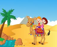 Happy kids riding camel Stock Images