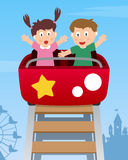 Happy Kids on Roller Coaster. Two happy kids having fun on roller coaster at the amusement park. Eps file available Stock Photos