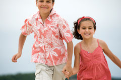 Happy kids running Stock Image