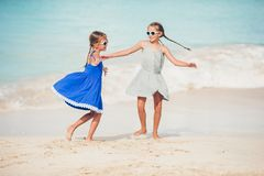 Happy kids running and jumping at beach royalty free stock photo
