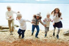 Happy Kids Running by Lake Royalty Free Stock Photography