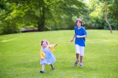 Happy kids running in a park Royalty Free Stock Images