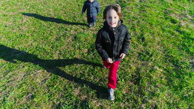 Happy Kids Running. Two happy kids brothers running on a field, slow motion stock video