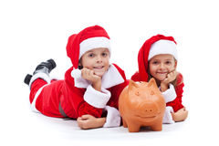 Happy kids saving for the christmas presents Royalty Free Stock Image
