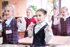 Happy kids in school class. Children have doing exercises. Primary School royalty free stock images