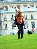 Happy kids, school girl and her little brother in city park Stock Images