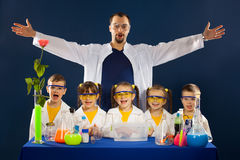 Happy kids with scientist doing science experiments in the laboratory Royalty Free Stock Image