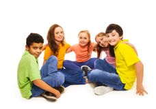 Happy kids in semi-circle Royalty Free Stock Photos