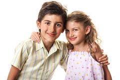 Happy kids sharing a hug Stock Image