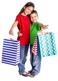 Happy kids with shopping bags Stock Photo