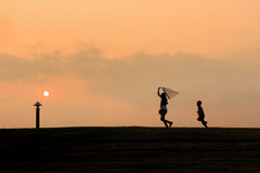 Happy kids silhouettes. On hill royalty free stock image