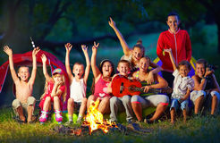 Happy Kids Singing Songs Around Camp Fire Stock Image