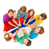 Happy kids sitting in a circle with flag of Russia Stock Photos