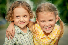Happy kids sitting on the road. Concept Brother And Sister Toget Royalty Free Stock Photos