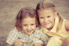 Happy kids sitting on the road. Royalty Free Stock Photo