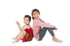 Happy kids sitting on white background. Royalty Free Stock Photography