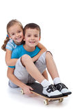 Happy kids with skateboard. Hugging and smiling Royalty Free Stock Photos