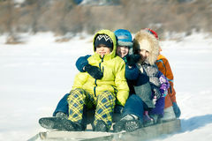 Happy kids sledding Royalty Free Stock Photos