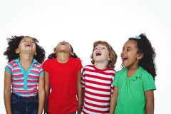 Happy kids smiling and looking up. Against a white background Royalty Free Stock Images