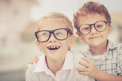 Happy kids standing on the road at the day time. Stock Images