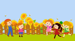 Happy kids and sunflower Stock Photos