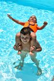 Happy kids in the swimming pool stock photos