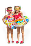 Happy kids in swimsuit and inflatable rings Royalty Free Stock Images