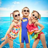 Happy kids in swimsuit at sea Stock Photo