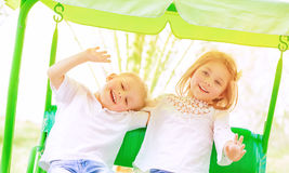 Happy kids on the swing Stock Image