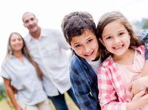 Happy kids with their family Stock Photography
