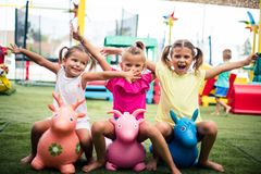 We are happy kids. Three little girls playing in playground. Space for copy. Looking at camera royalty free stock photography