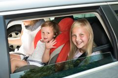 Happy kids traveling by car Stock Image
