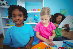 Happy kids using modelling clay together royalty free stock photos